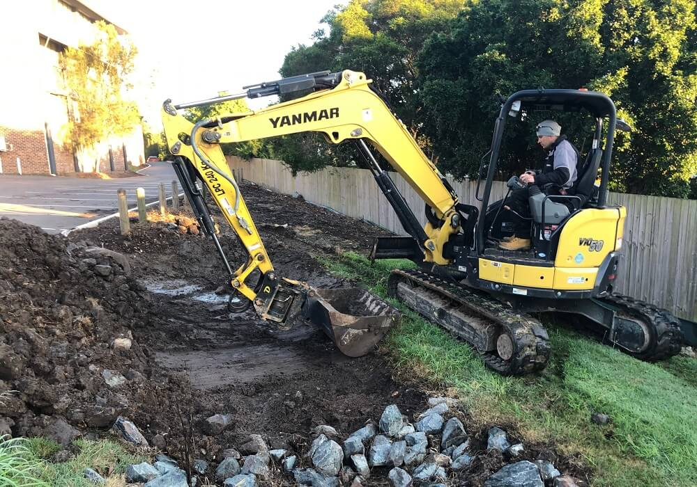 5T EXCAVATOR - CLEANING OUT DRAIN